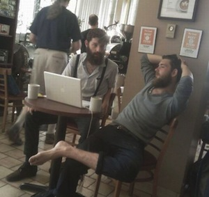 hipster dudes working in a coffee shop